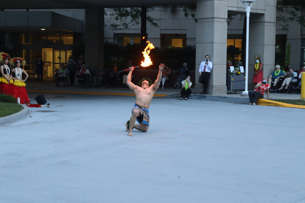 a man performs a traditional Polynesian fire dance